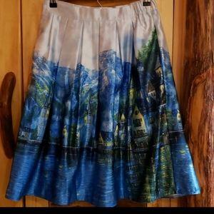 Nestled by the sea pleated midi skirt
